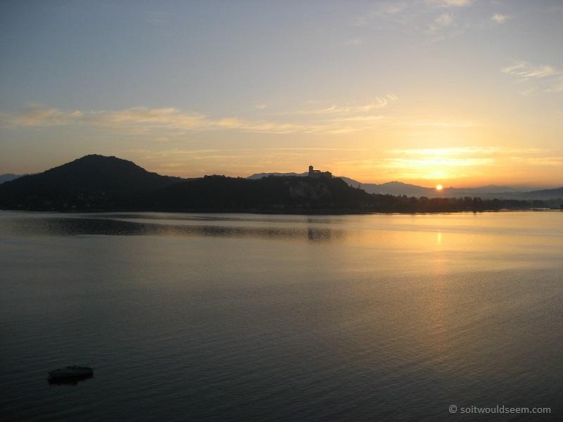 sunrise over lake maggiore, arona, italy
