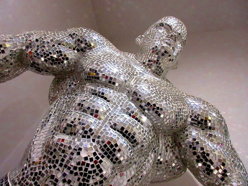 Mosaic mirror man statue in gym reception area