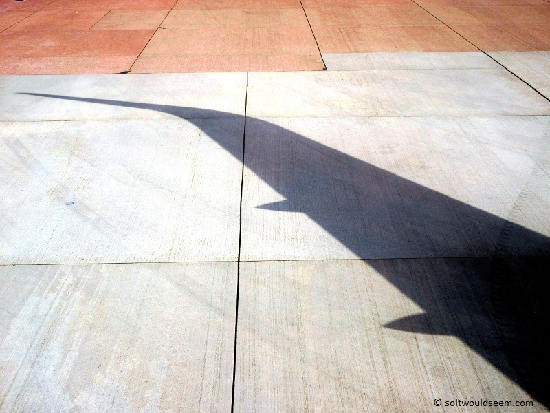 Shadow of an aircraft wing (LH0943 bound for Frankfurt) on the taxiway at Manchester Airport