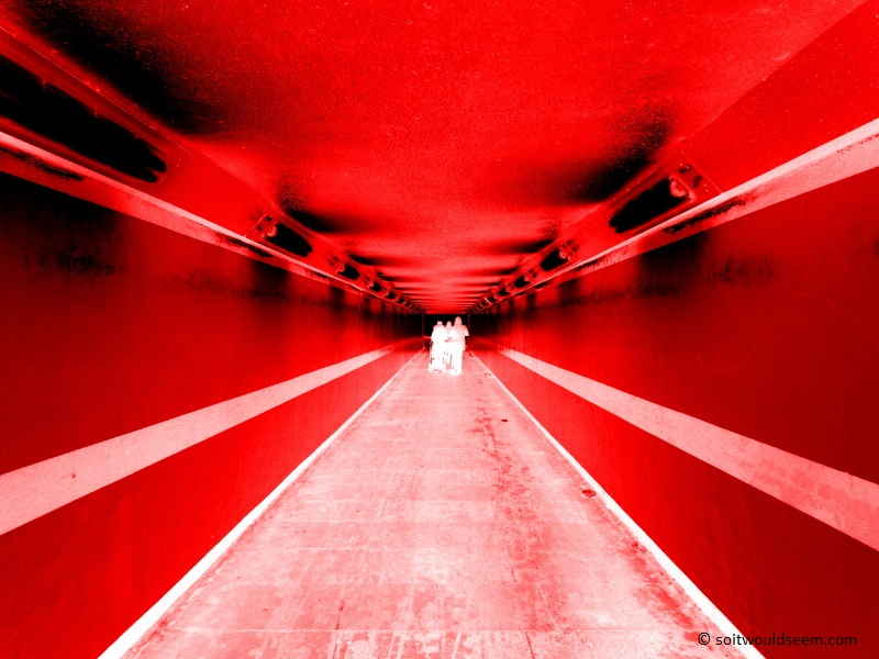 Welcome To Mars - people walking through a subway, inverted (negative image) and colourised