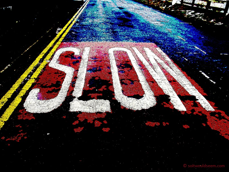 Slow - road markings, posterised (number of colours reduced) and contrast increased to produce a bold image